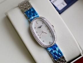 顶级复刻手表浪琴女款白盘钢带圆舞曲系列石英腕表